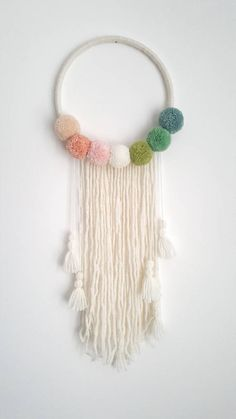 Pompom Wall Hanging - Custom To Order  Make your wall beautiful with this soft pompom dreamcatcher! Perfect for any room! The base is a natural wood hoop made of pompoms.   Size guide: Approximately diameter 28cm/11inch  Please do not hesitate to contact me if you would like further options with regards to colour pompoms and I will work with you to create your perfect wall decor.    NB. This item is for decorative purposes only, this is not a toy, please handle with care.  Louise X