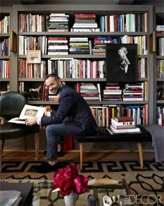 Books on design, architecture, and art rest on shelves that Francisco Costa, Calvin Klein's creative director for women's , had framed in brass, taking inspiration from the bookcases Albert Hadley created for Brooke Astor.