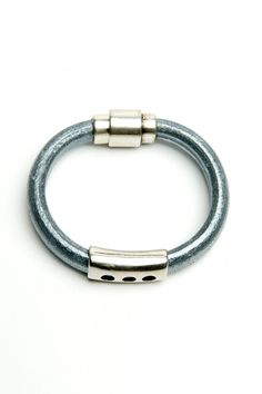 A Beautiful Metallic Gunmetal Leather Bracelet with a 3-hole silver spacer and magnetic clasp. Dressy enough to wear to the office; fun enough to pair with jeans. 7.5 inches around; gives with wear and body heat.  Metallic Gunmetal Bracelet by bella Forte Boutique. Accessories - Jewelry - Bracelets Utah