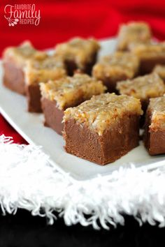 Looking for the perfect fudge recipe but with a little twist? You are going to love this rich, smooth chocolate fudge topped with a chewy coconut topping!
