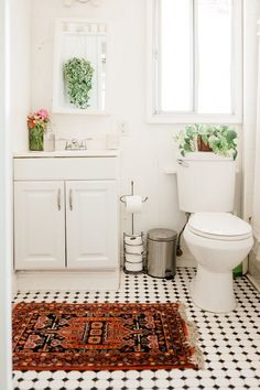 black and white bathroom with colorful rug