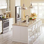 This airy kitchen features Ox Hill PureStyle™ kitchen cabinets in Heavy Cream finish and new Sierra quartz countertop, both from Martha Stewart Living™, available exclusively at The Home Depot.