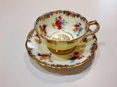 Check out this item in my Etsy shop https://www.etsy.com/listing/211434403/paragon-demitasse-cup-and-saucer-yellow
