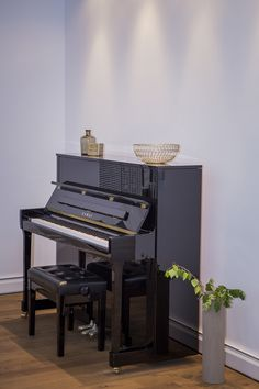 Old beautiful piano in a modern interior design renovation. A project in Bucharest.