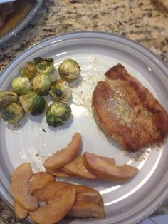 pork chops dusted in coconut flour and fried in coconut oil, brussel sprouts and apples with coconut milk and cinnamon