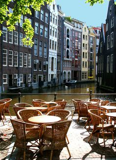 Cafe on a canal in Amsterdam, The Netherlands. Amsterdam, capital of the Netherlands, has more than one hundred kilometres of canals, about 90 islands and bridges. Places Around The World, Oh The Places You'll Go, Places To Travel, Places To Visit, Around The Worlds, Dream Vacations, Vacation Spots, Wonderful Places, Beautiful Places