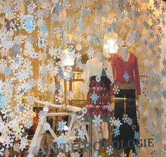Someone at Anthropologie's an expert with scissors and construction paper. Holiday windows aren't only for haute couture or high-end department stores: Anthropologie's Flatiron store is picture-perfect with hundreds of...