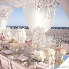 LOVE THIS! The only change, I would take out pink and use subtle pops of green, instead. LOVE the idea of chandeliers if we can ship them to island.