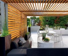 Outdoor Wooden Slats: A cedar slat canopy unifies and adds interest to a deck in Chicago