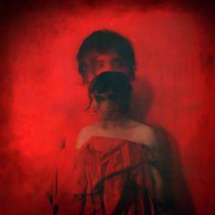 nights in red satin by Hanan Kazma :  self portrait - long exposure