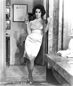 Party girl Elizabeth Tailor in a fabulous silk and lace slip dress (still from Butterfield Eight, 1960)
