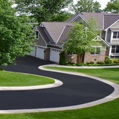 Asphalt driveway with concrete or other pavers lining the outside. It'd be great to do this in a u-shaped driveway.
