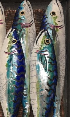 A close-up of some of my ceramic mackerel. I love the iridescent glazes on these… A close-up of some of my ceramic mackerel. I love the iridescent glazes on these fish. Ceramic Painting, Ceramic Art, Fish Wall Art, Fish Artwork, Clay Fish, Pottery Pots, Watercolor Fish, Fish Sculpture, Unicorn Art