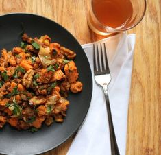 Chorizo and Sweet Potato Hash (For one: 1 sweet potatoe, peeled and diced, 1/2 cup walnuts, broken into pieces, 1/4 lb chorizo (or Italian sausage, if you prefer), casings removed, olive oil, 1/2 med onion, and 2 T chopped parsley)