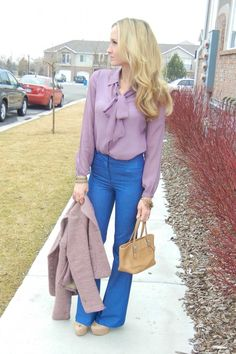 Tie blouse top with wide legged jeans.