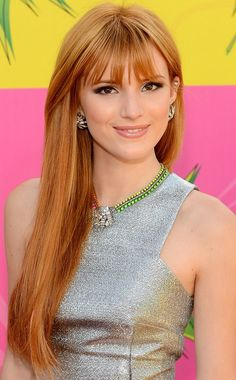 Bella Thorne Long Hairstyle: Strawberry-blonde Hair with Bangs