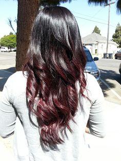 Dark brown to burgundy ombré hair.
