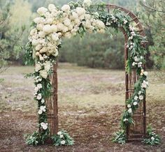"wedding arch - really pretty! (a little too ""over-the-top"" with amount of flowers, but I really like the general idea)"