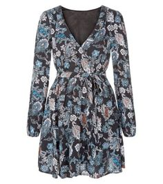 """Madam Rage. Wear bright paisley prints with this paisley print wrap dress. Pair with ankle strap heels to complete the look.- All over paisley print- Wrap front design- Tie waist- Simple long sleeves V neckline- Mini length- Model is 5'8""""/176cm and wears UK 10/EU 38/US 6"""