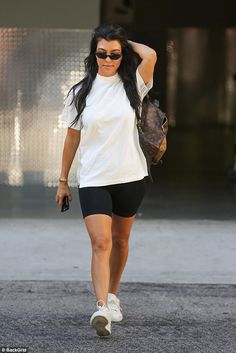 On your bike... Kourtney Kardashian rocked a casual look when she stepped out in LA's Calabasas on Tuesday