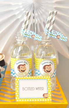 Curious George themed birthday party water bottles with paper straws. cc: @Lisa Mallaiah