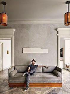 Sofa moderno con base de madera