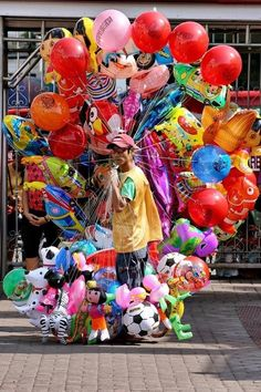 Our balloon vendor for the festival. World Of Color, Color Of Life, Bubble Balloons, Bubbles, Magazine Pictures, Over The Rainbow, Colorful Pictures, Kite, Belle Photo