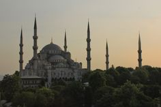 https://flic.kr/p/ab6hCr | Istanbul: Blue Mosque at sunset | The Sultan Ahmed Mosque (Sultanahmet Camii) is the most magnificent mosque in Istanbul. Its importance is indicated by the six minarets--four surrounding the mosque and two at the far end of the courtyard (on the right). It is popularly known as the Blue Mosque for the blue Iznik tile adorning the walls of its interior. It was built by the architect Sedefhar Mehmet Ağa between 1609 and 1616, during the rule of Ahmed I. View of…