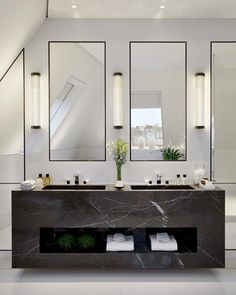 The master bathroom double vanity in the Penthouse is carved from a single block of