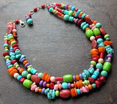 $155 three strands of gems, crystals, and coral in bright cheerful colors in various shapes -- such as nugget, tube, rondell, rounds, pebble, barrel, oval, faceted rondell,  and heishi...stones such as turquoise, tangerine & melon coral, sugilite, orange crystals, lime turquoise, sponge coral, and red sea bamboo coral.