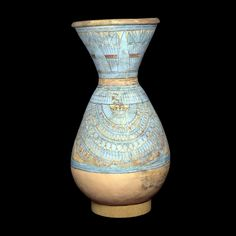 Blue-painted pot  From Tell el-Amarna, Egypt  18th Dynasty, around 1300 BC  Biconical pottery jar, decorated with a design in blue, red and black