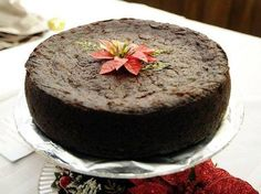There are many Jamaican Christmas traditions that I love, but one that I just can't live without is the Jamaican Fruit Cake. This fruit cake is a dense cake filled with mixed fruits, currants and a… Jamaican Fruit Cake, Black Cake Jamaican, Jamaican Christmas Cake, Black Cake Recipe, Jamaican Dishes, Jamaican Recipes, Jamaican Cuisine, Jamaican Desserts, Guyanese Recipes