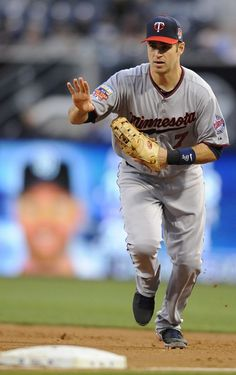 May 20, 2014; San Diego, CA, USA; Minnesota Twins first baseman Joe Mauer (7) fields a ground ball during the third inning against the San Diego Padres at Petco Park. Mandatory Credit: Christopher Hanewinckel-USA TODAY Sports