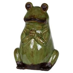 Ceramic frog statuette in green.   Product: Frog statuetteConstruction Material: CeramicColor: G...