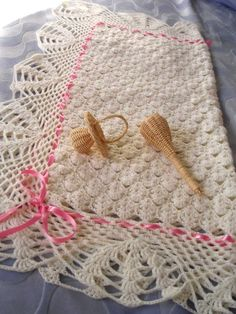 Simple shell pattern with lacy edge makes a beautiful backdrop for a woven ribbon finishing.