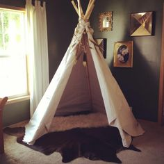 TEEPEE GARLAND By: The Modern Momma gold dipped feathers and logs