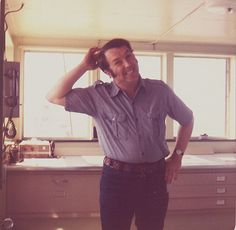 Edmund Fitzgerald 1974 Third Mate Mike Armagost in the chart room on the Fitz. You can just barely make out her stack and after cabin through the window below his elbow. Behind him is one of the radio units aboard the boat.