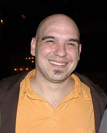 Michael D. Symon (born September 19, 1969) is a James Beard Foundation Award-winning American chef,[1] restaurateur, television personality, and author. He is seen regularly on Food Network on shows such as Iron Chef America, Food Feuds, and The Best Thing I Ever Ate, as well as Cook Like an Iron Chef on the Cooking Channel and The Chew on ABC. He has also made numerous contributions to magazines and periodicals such as Bon Appétit, Esquire, Food Arts, Gourmet, Saveur and O, The Oprah Magazine.
