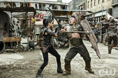 """The 100 -- """"Die All, Die Merrily"""" -- Image HU410a_0040-- Pictured (L-R): Marie Avgeropoulos as Octavia and Chai Hansen as Ilian -- Credit: Bettina Strauss/The CW -- © 2017 The CW Network, LLC. All Rights Reservedpn"""