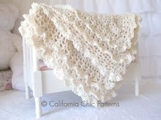 The beautiful Victorian baby blanket featuring double lace edging is sure to delight any mom. Victorian is the crochet baby blanket pattern #89 by Cali Chic Patterns.   Available for purchase now.