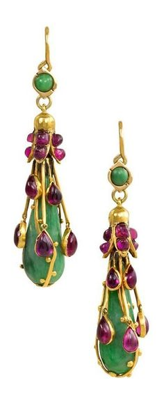 A pair of Art Nouveau gold, jade, and ruby earrings, English, circa 1905. The pear-shaped jade pendants suspending from gold foliate and cabochon ruby caps and decorated with gold wire and articulated cabochon ruby drops, in 15k. England, Dutch import marks. #ArtNouveau