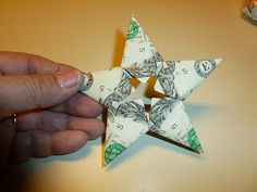 """""""Easy money"""" folded five pointed origami star -    Every year around Christmas I fold origami stars out of five one-dollar bills. Sometimes I leave them as tips in restaurants. (And many times the waiters or waitresses follow me out to ask how to do it) Other times I give them as gifts with a string attached for hanging on the tree."""