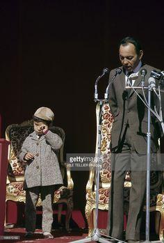 Close-Up Of The King Hassan Ii Of Morocco. Au Maroc, en janvier 1968, le Roi HASSAN II, portant un costume cravate, durant un discours devant des micros, et son fils Mohamed, portant un costume et une casquette.