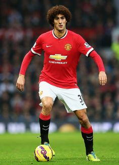 Marouane Fellaini of Manchester United in action during the Barclays Premier League match between Manchester United and Hull City at Old Trafford on November 29, 2014 in Manchester, England.
