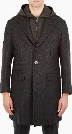 Neil Barrett Charcoal Double-Layer Wool Coat The Neil Barrett Double-Layer Wool Coat for AW16, seen here in charcoal. - - - This unique coat from Neil Barrett is crafted in Italy from premium wool and cut to offer a standard fit. It features dou http://www.comparestoreprices.co.uk/january-2017-6/neil-barrett-charcoal-double-layer-wool-coat.asp