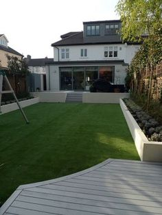 modern minimalist garden design low maintenance high impact garden design raised white wall beds grey decking east grass lawn turf sunken garden with fire and chimney flat trees balham wandsworth london 4 Modern Landscape Design, Modern Garden Design, Modern Landscaping, Deck Design, Backyard Landscaping, Landscaping Ideas, Modern Patio, Garden Decking Ideas, Simple Garden Designs