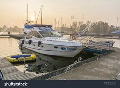 Szczecin, Poland - October 31, 2015: Variety Of Boats Are Moored To A Pier In The Harbor Of Dabie Lake In The Morning Stock Photo 334460795 : Shutterstock