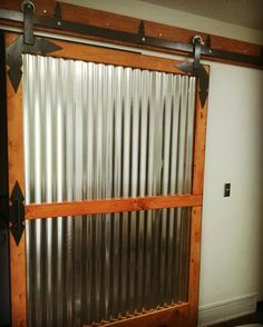 Custom built barn door the corrugated tin keeps the room bright and clean looking