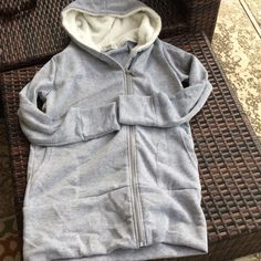 Heather Gray hoodie.  BNIP. Nicely full of cozy warmth.  Hooded area is accented with a light Sherpa lining and extends to make a fuller collar. Jackets & Coats