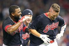 Cleveland Indians Brandon Guyer celebrates with Abraham Almonte and Tyler Naquin…